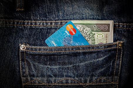 blue Mastercard card in blue denim bottoms pocket