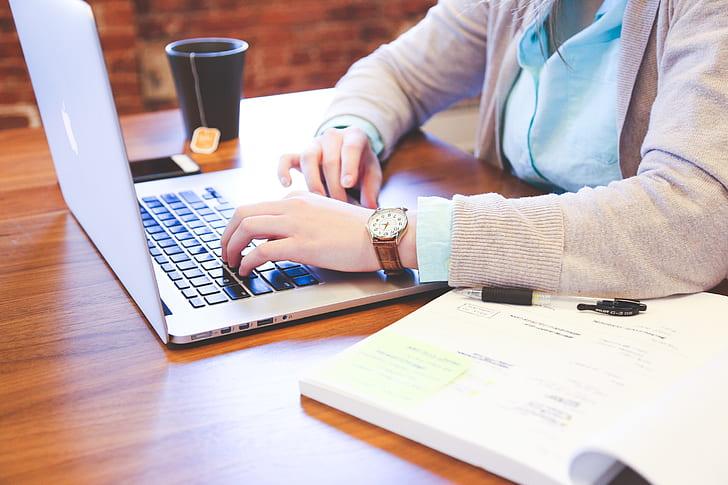 Royalty-Free photo: Person using laptop computer | PickPik