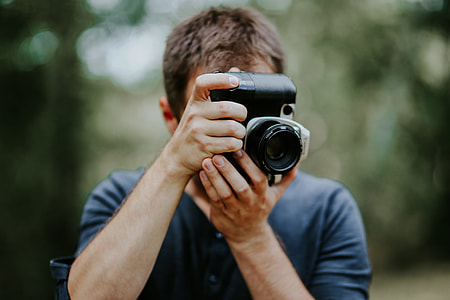 Photographer taking photos of a beautiful, young woman