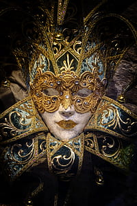 low light photography of gold mask