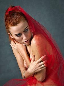 woman wearing red mesh veil