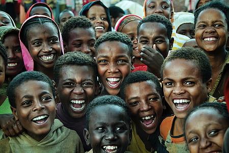 group of children smiling at daytime