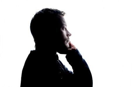 man wearing black long-sleeved top