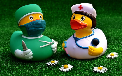 two doctor and nurse rubber duckies