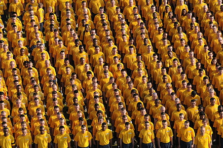 high-angle photography of men wearing yellow shirts