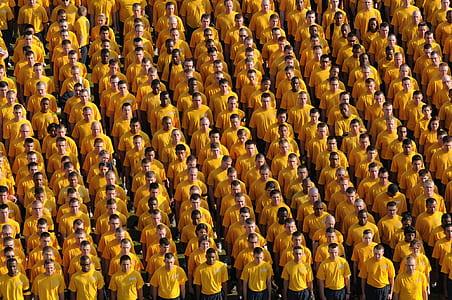 high-angle photography of men wearing yellow shirts