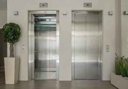 two grey elevators