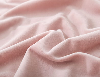 close up photo of pink fleece textile