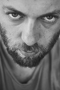 grayscale photo of man with black beards