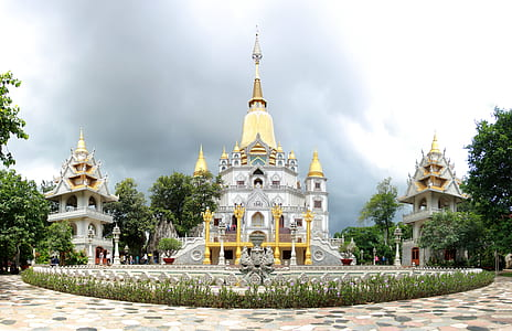 yellow and gray concrete temple with towers