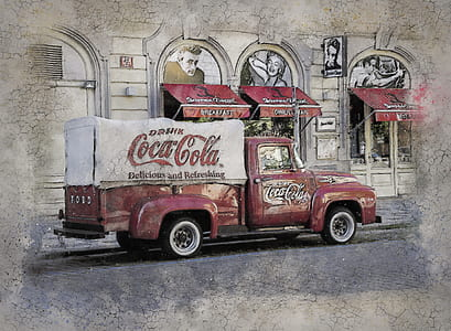 red and white Coca-Cola truck near building