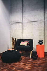 Collection of chairs and tables arranged at a design exhibition