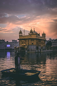 photo of golden temple during sunset