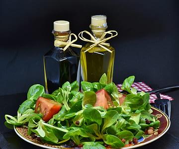 vegetable salad with olive oil bottles