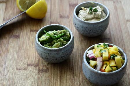 three grey ceramic bowls with fruits