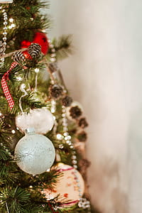 gray baubles on Christmas tree in close-up photography