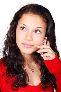 woman listening to her candybar phone photograph