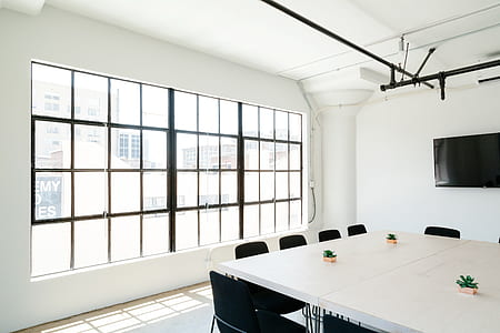 white wooden conference table