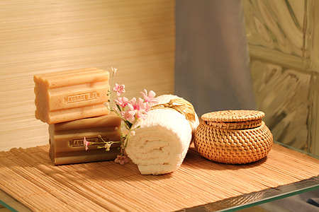 two massage soap bars beside white towel on table