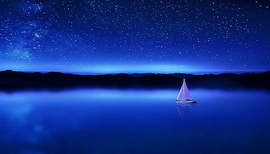 white boat near island during nighttime