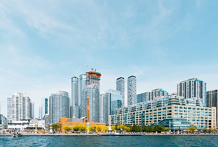 landscape photography of city near body of water during daytime