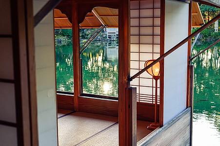 photo of open window house near body of water