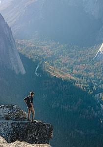 man on mountain cliff during daytime