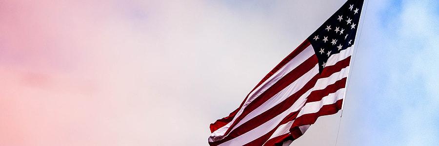 shallow focus photography of U.S. flag
