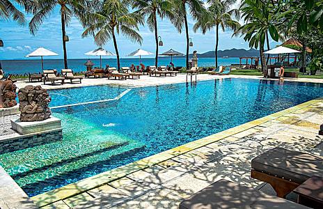 blue pool near body of water