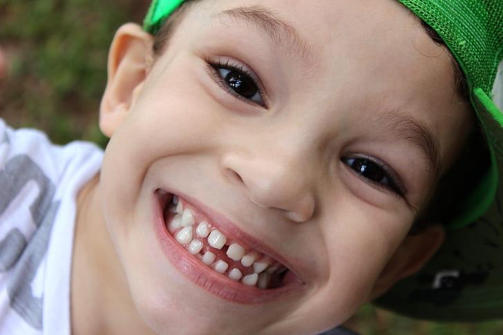 boy wearing green cap