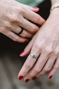 Detail of woman's hands and jewelry