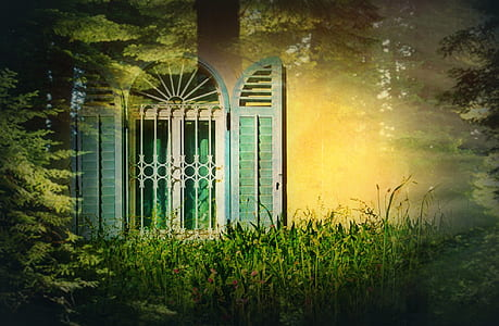 open white and teal wooden window with white metal grill beside green grass field