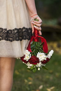 woman holding bouquet of white flowers