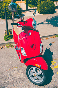 red and gray motor scooter
