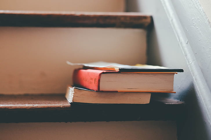 two books on stairs