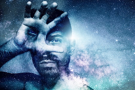 man covering right eye with nebula effects