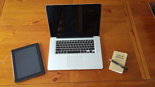 MacBook on table near space gray ipad