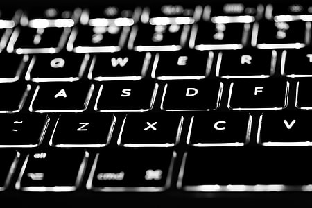 Macro shot of the backlit keyboard of a laptop, image captured with a Canon DSLR and 100m macro lens