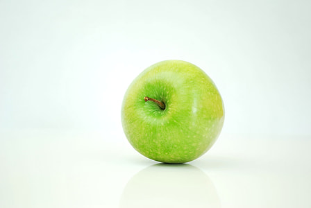 green apple with white background