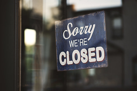photo of blue wooden Sorry we're Closed signage