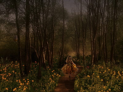 woman walking in the middle of forest with yellow flower field