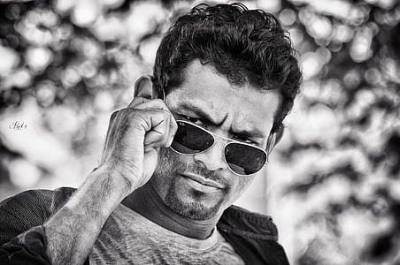 grayscale photography of man in aviator sunglasses