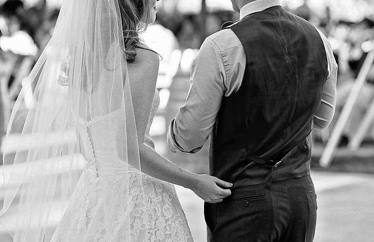 grey scale photography of bride and groom