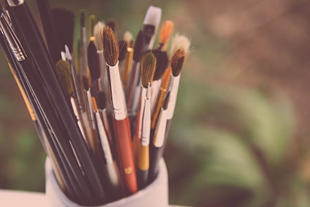 selective focus photography of paint brushes