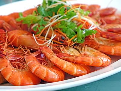 stewed shrimps on white ceramic platter