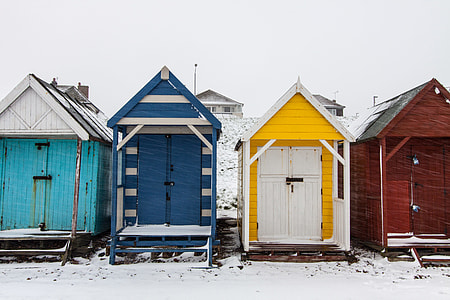 Winter-time scene of snow covered beach huts on the Kent Coast in Southern England