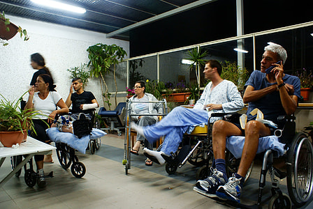 five patients sitting on wheelchairs