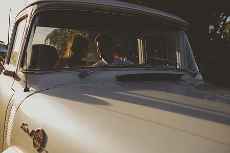 couple inside classic vehicle