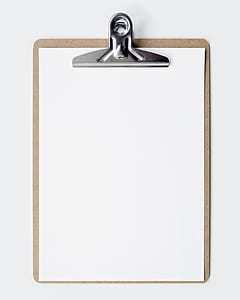 brown clipboard with white printing paper