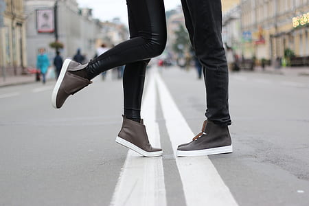 woman and man both wearing brown high top shoes
